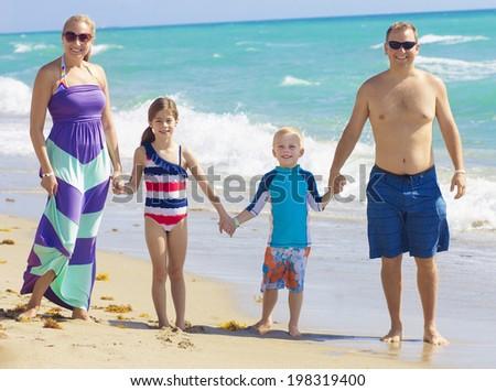 Family Vacation Fun at the Beach - stock photo