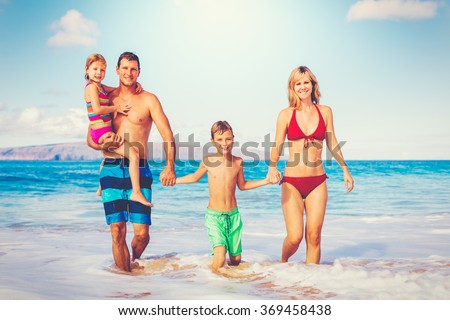 Family vacation. Happy family having fun on beautiful warm sunny beach. Outdoor summer lifestyle. - stock photo