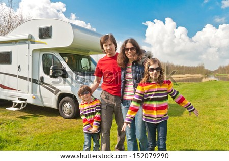Family vacation in camping, holiday trip in camper. Happy active parents with kids travel on RV. Family having fun near their motorhome. Spring vacation trip with children.  - stock photo