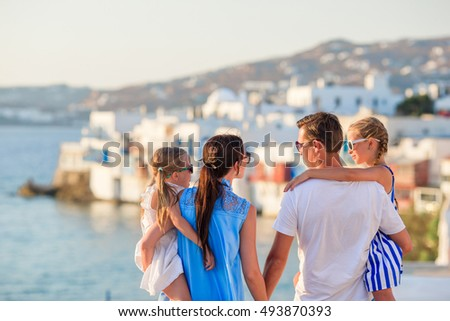 Family Vacation In Europe Parents And Kids On Little Venice Background Mykonos Island