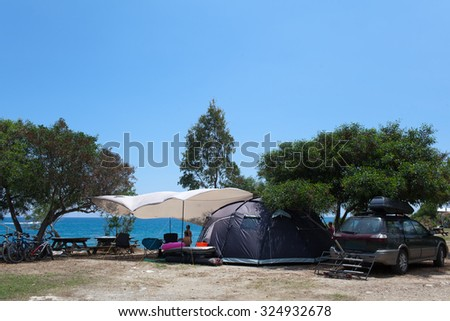 Family vacation in the camp. Travel with kids and tents