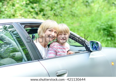 Family vacation. Mom with her child in car trip.