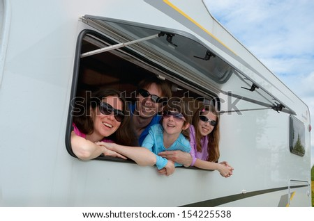 Family vacation, RV travel with kids, happy parents with children on holiday trip in motorhome  - stock photo