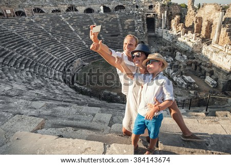 Family vacation selfie photo in antique amphitheater ruins in Side, Turkey - stock photo