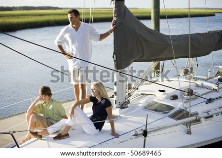 Family vacation together on sailboat on sunny day, on Florida intracoastal waterway - stock photo