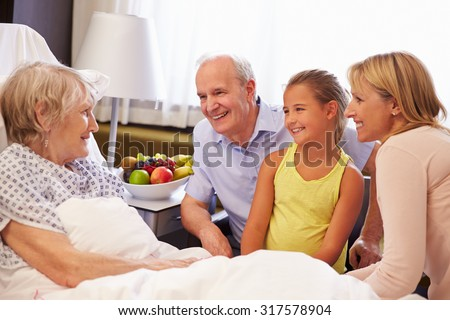 Family Visit To Grandmother In Hospital Bed - stock photo