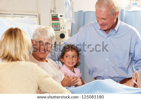 Family Visiting Senior Female Patient In Hospital Bed - stock photo