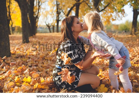 Family walk autumn park - stock photo