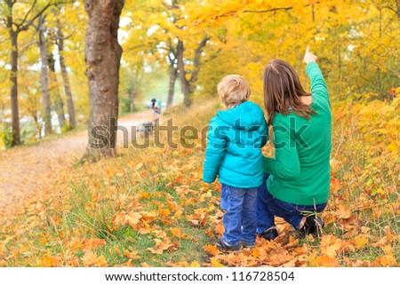 family walk in autumn - stock photo