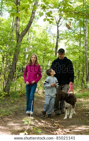 family walking a dog