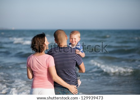 Family walking by the sea