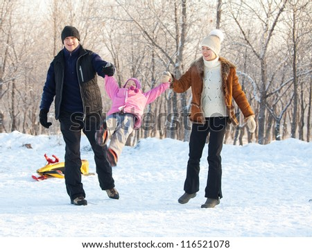 Family walking . Happy parents with child