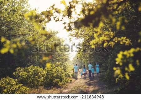 Family walking in the forest  - stock photo