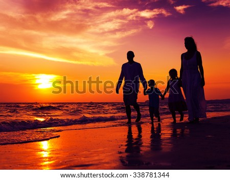 Family walking on the beach happiness Concept - stock photo