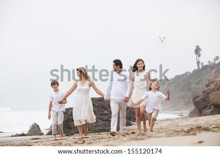 Family walking on the beach with Mom and Dad in Malibu California - stock photo