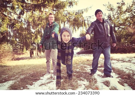 Family walking on their way to get a Christmas tree - stock photo