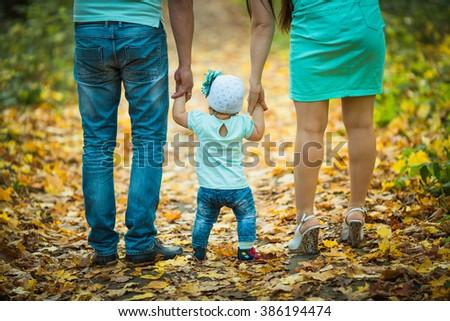 Family walks in the autumn park  - stock photo