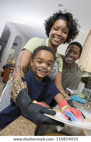 Family Washing Dishes - stock photo