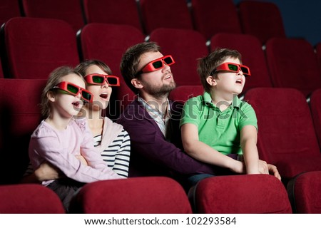 Family watching a 3D movie - stock photo