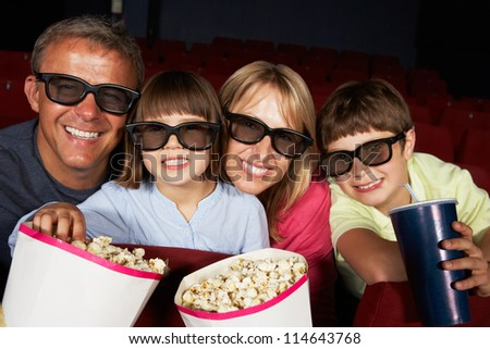 Family Watching 3D Film In Cinema - stock photo