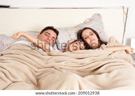 Family who slept together, waking up . - stock photo