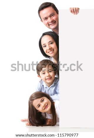 Family with a banner smiling - isolated over a white background