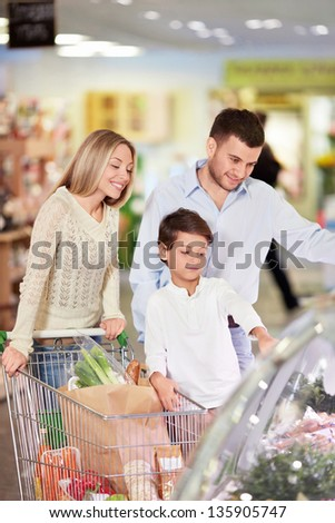 Family with a child in a store