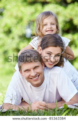Family with a child in park - stock photo