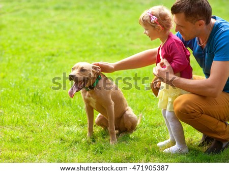 family with a dog in the park