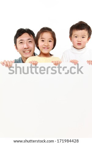 family with a white board