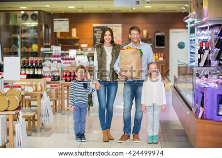 Family with bag in store - stock photo