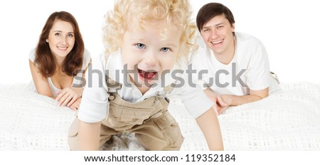 Family with child. Happy parents playing with baby - stock photo