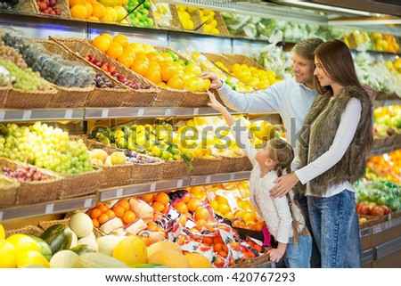 Family with child in a store