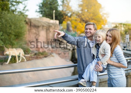 Family with child in zoo - stock photo