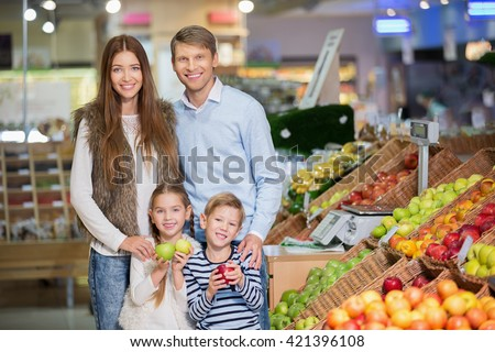 Family with child indoors - stock photo