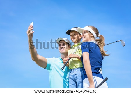 Family with child making selfie