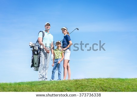 Family with child on a golf course - stock photo