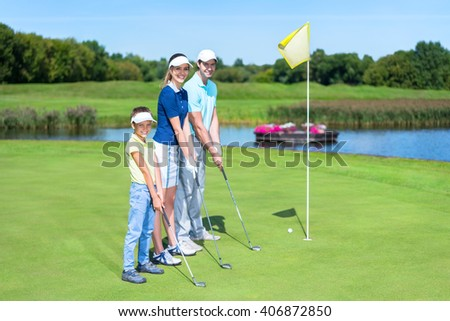 Family with child on golf course