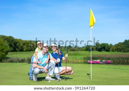 Family with child on the golf course - stock photo