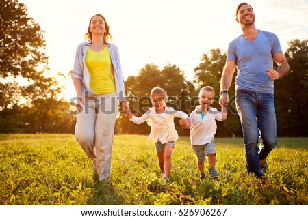 Family with children enjoying in park together