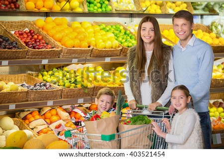 Family with children in a store - stock photo