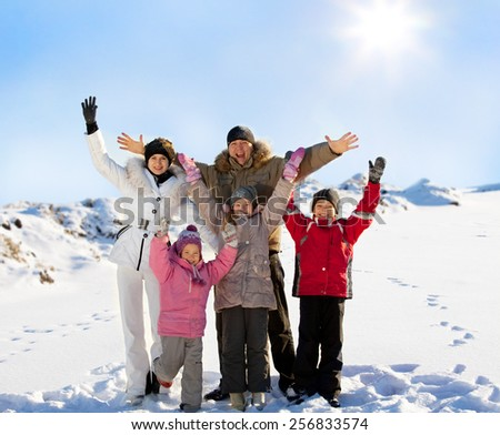 Family with children in the snow in winter. - stock photo
