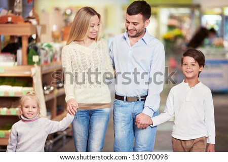 Family with children in the store - stock photo