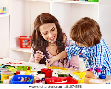 Family with children  painting  in school. Education.