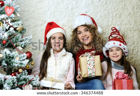 family with Christmas gifts - stock photo