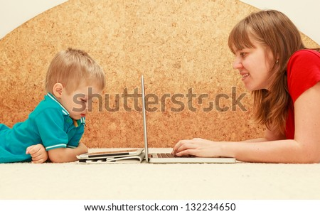 family with computer and touch pad at home - stock photo