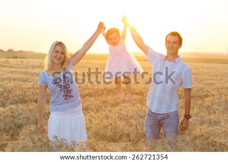 family with daughters outdoors at sunset   - stock photo