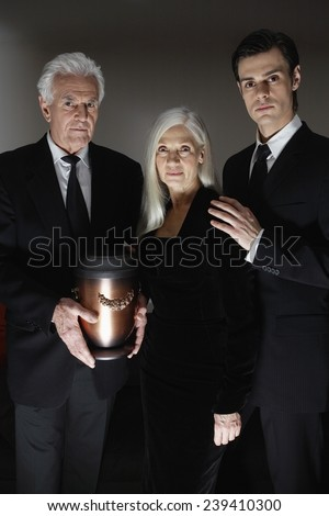 Family with Funeral Urn - stock photo
