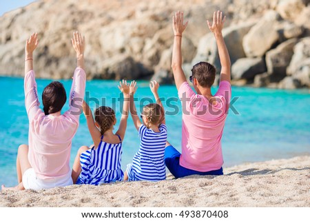 Family with kids on the beach
