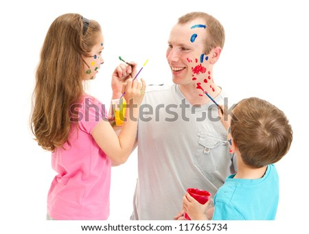 Family with kids painting on dad face. Isolated on white.